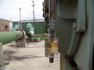 olie inspektie glas met water detektie